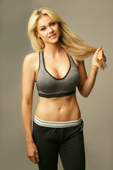 Beautiful blond woman in sexy sportswear