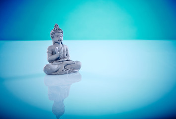 Grey buddah in lotus pose