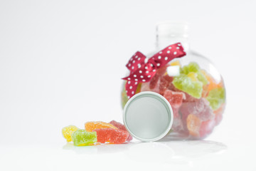 Candy in a bottle on a white background
