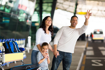 man  family hailing taxi