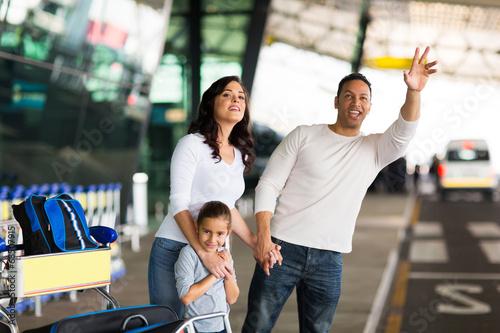 man  family hailing taxi - 68507915