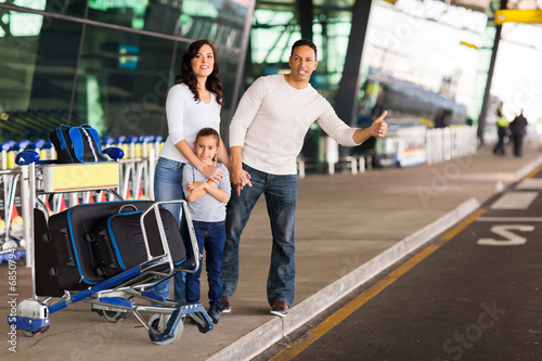 family hailing for a taxi - 68507945