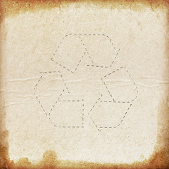 Grunge paper background with recycle symbol