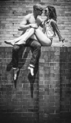 Middle Age Romantic Couple Kissing Above Wall