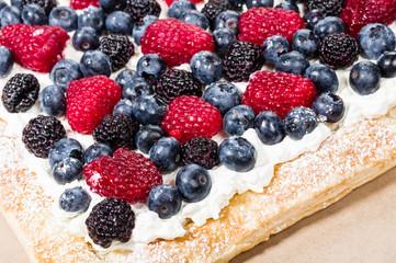 Homemade berry tart with fresh cream