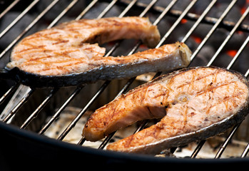 Delicious salmon cutlet steaks on the grill