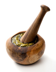 Wooden pestle and mortar with fresh pesto