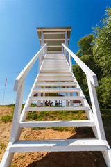 white lookout tower at a beach
