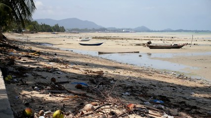 Dirty Beach with Old Fishing Boats.