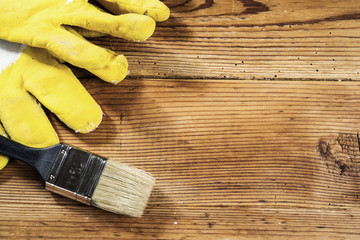 gloves and brush on wooden background