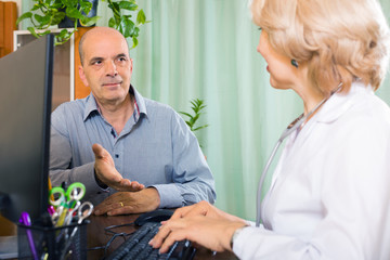 aged  doctor talking with mature male patient