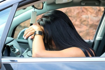 woman sleeping in a car