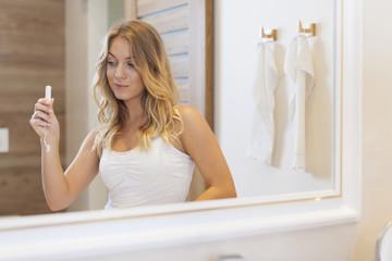 Blonde woman during menstruation in bathroom
