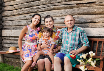 happy family on background wooden wall