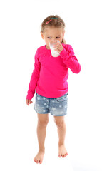 Little girl drinking glass of milk