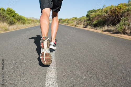 canvas print picture Fit man jogging on the open road