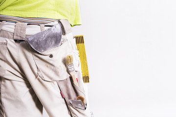Man buttocks with tools in his pocket