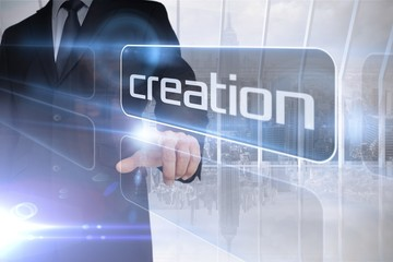Businessman presenting the word creation