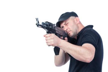 Man pointing AK-47 machine gun, isolated. Focus on the gun