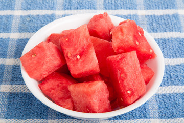 Cut Watermelon Chunks in White Bowl