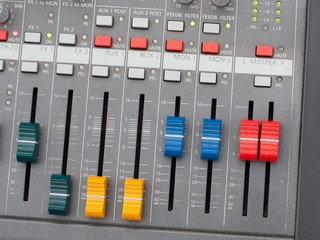 Top view of music mixer with controls