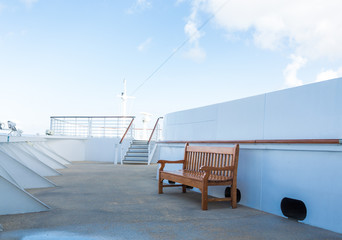 Wood Bench on White Cruise Ship