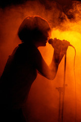 Concert photo of female singer holding microphone