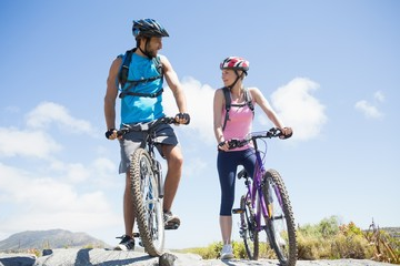 Fit cyclist couple taking a break