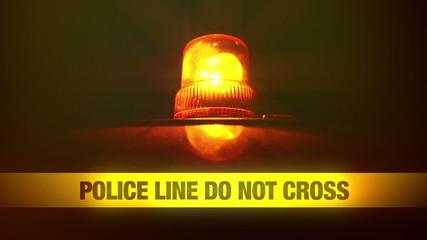 Police Line Do Not Cross Tape and Orange Flashing Light