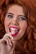 redhead girl with a lollipop candy