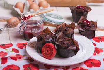 Chocolate muffins with sweet jam