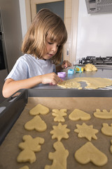 Little girl making cookie dough