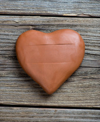 clay heart on wood background