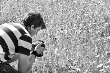 handsome photographer/videographer in botanic gardens