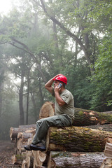 Lumberjack with cellphone
