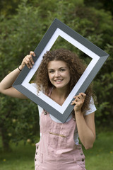 Portrait of teenage girl in a frame