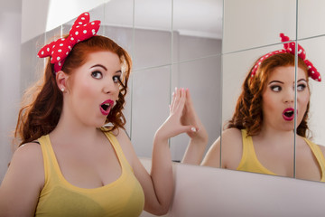 beautiful redhead girl with colorful pinup clothes
