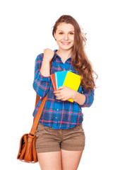 Happy young student girl holding books,