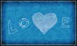 Word ''love'' with abstract heart on blue background