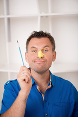 Handsome father with paintbrush