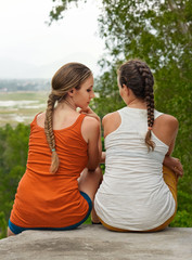 friendship, happiness and people concept - two girls outdoor.