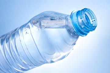 Open a bottle of water on blue background