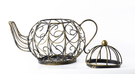 Metal wireframe teapot on white