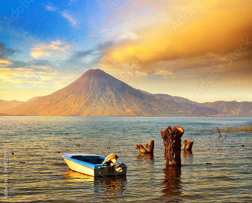 Leinwanddruck Bild Beatiful sunset at the lake Atitlan near the volcano.
