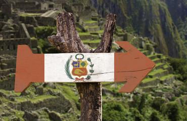 Peru wooden sign isolated on Machu Pikchu background