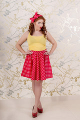 View of a beautiful pinup redhead girl with skirt.