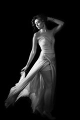 Glamorous woman wearing evening dress in black and white