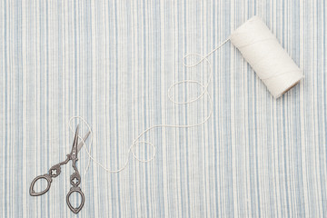 Threads And Scissors On Natural Linen Striped Textile