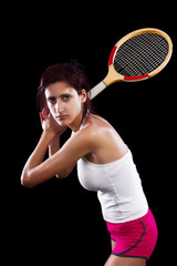 Beautiful young girl with a tennis racquet