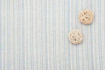 Rattan Balls On Natural Linen Striped Textile